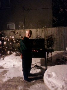 Cliff, happily grilling in the snow.