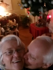 Old People under the mistletoe taking a selfie.